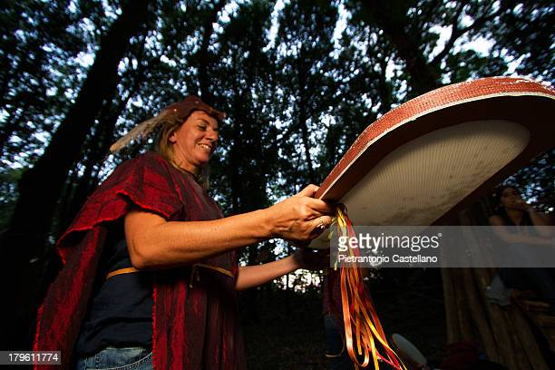 "Sea-drum"", an instrument to resemble sound of waves on shore, is played by folk musician Sara Frazzica during her band's concert in Cuma Regional..."