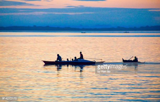 Sea-faring people on native boats