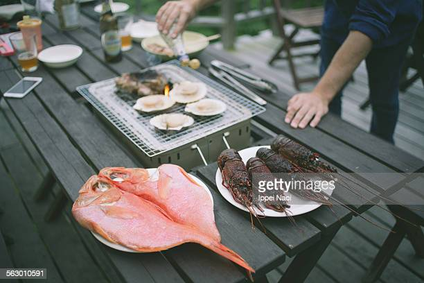 Seafood BBQ with spiny lobsters, scallops and fish