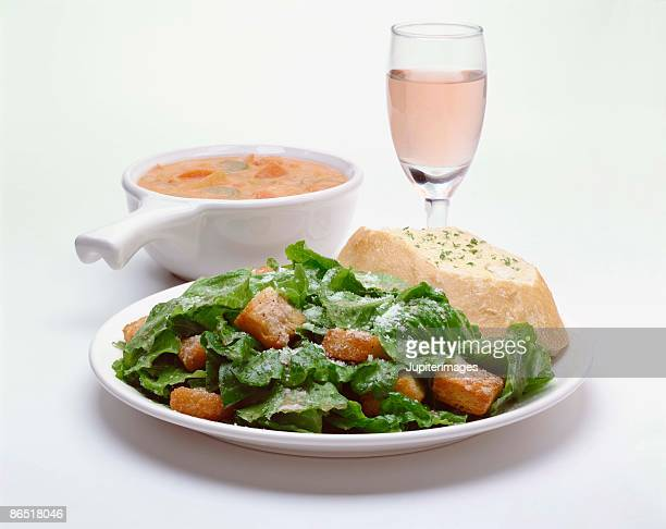 Seafood bisque , caesar salad , and bread