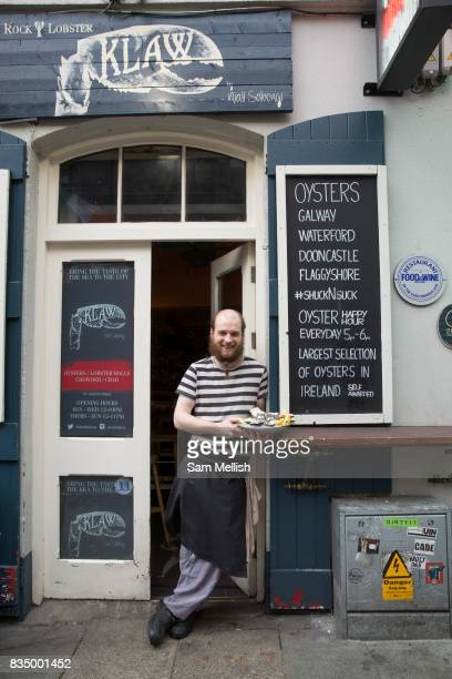 Seafood chef from Klaw restaurant holding a seafood platter on 3rd April 2017 in Dublin Republic of Ireland Dublin is the largest city and capital of...