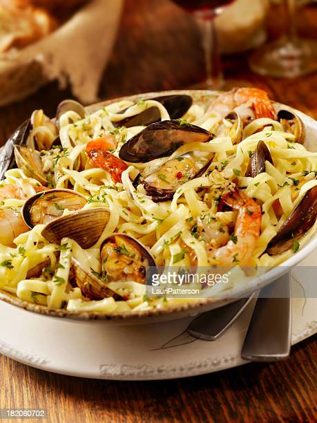 seafood linguini - bechamel sauce stock photos and pictures