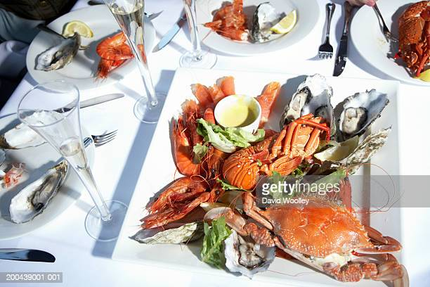 Seafood lunch on table set with champagne flutes