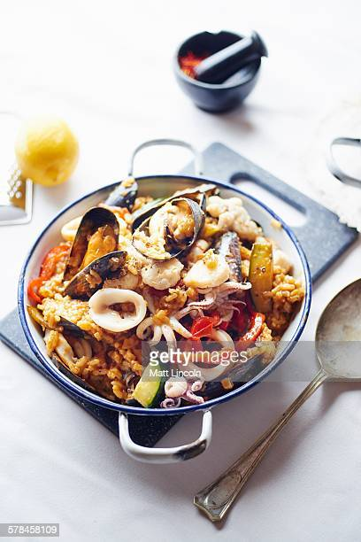 seafood paella, close-up - matt calamari stock photos and pictures