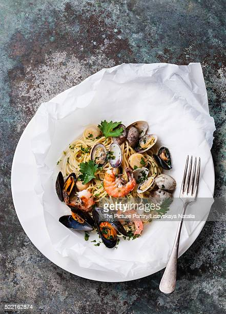 Seafood pasta - Spaghetti with clams, prawns, sea scallops on wh
