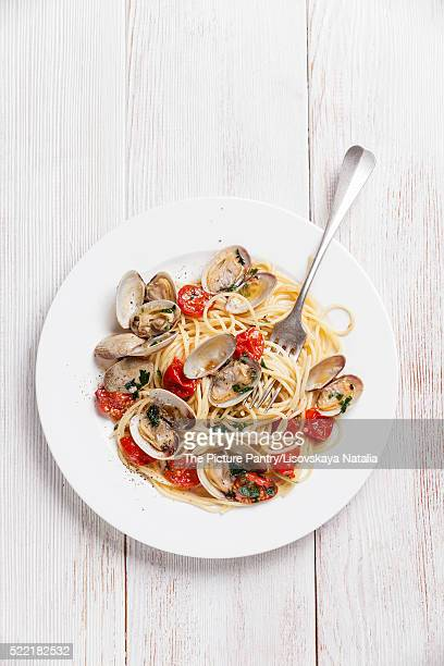 Seafood pasta with clams in tomato sauce Spaghetti Vongole on wh