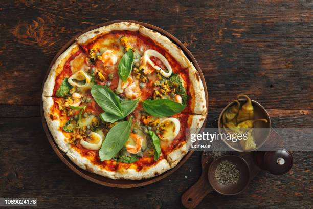 seafood pizza - italian culture stock pictures, royalty-free photos & images