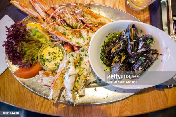 a seafood platter in a restaurant in bergen, norway wintertime - bergen norway stock pictures, royalty-free photos & images