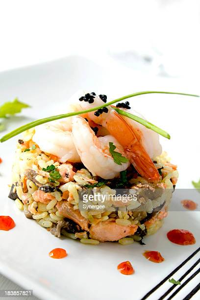 A seafood risotto on a white plate