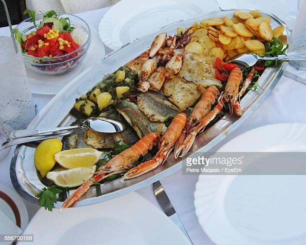 Seafood Served On Dining Table
