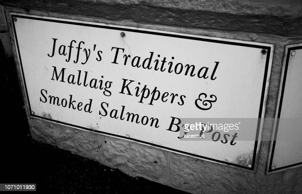 seafood shop sign in mallaig village, scotland - mallaig stock photos and pictures