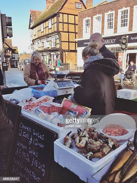 Seafood stall at the farmers market in Wantage market square England