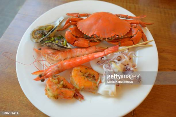 seafood vietnamese food, crab, king shrimps, squid, clams - chilli crab stock photos and pictures