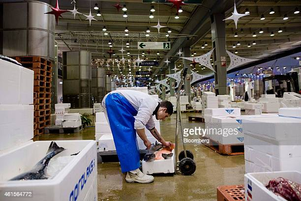 A seafood wholesaler inspects crates of fresh fish inside Rungis wholesale food market in Rungis France on Thursday Jan 15 2015 Bank of France...