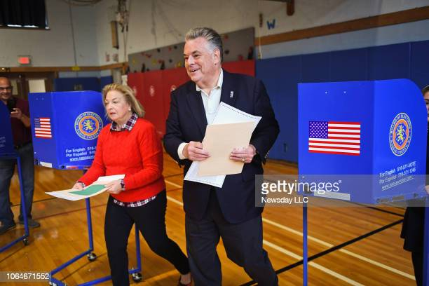 Representative Peter King and his wife Rosemary hand in their completed ballots as voters turn out at the Manor Elementary School in Seaford New York...