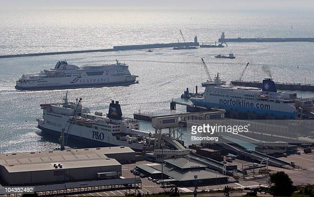 A SeaFrance ferry top passes a PO ferry left and a Norfolkline branded DFDS A/S ferry at the port of Dover UK on Wednesday Sept 22 2010 Dover Harbour...