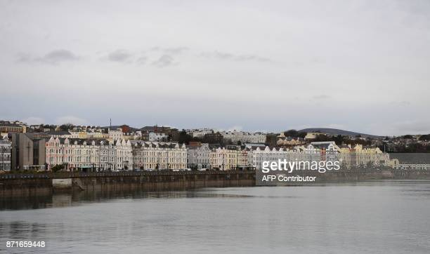 Seafront properties line the coastal road in Douglas on the Isle of Man an island in the Irish Sea off of the west coast England on November 8 2017...