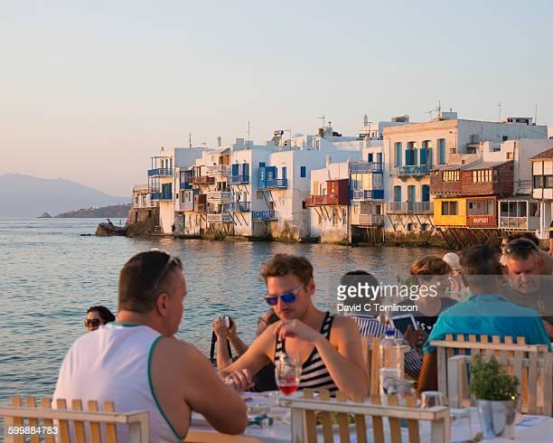 Seafront taverna at sunset, Mykonos Town, Mykonos