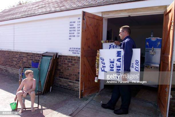 Seafront trader Gary Grainge from Frinton Essex agreed to stop selling ice cream at Frinton On Sea Gary Grange packs his icecream sign away from his...