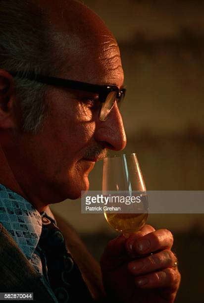A Seagrams distillery employee noses a single malt Scotch whiskey being tested in the company laboratory