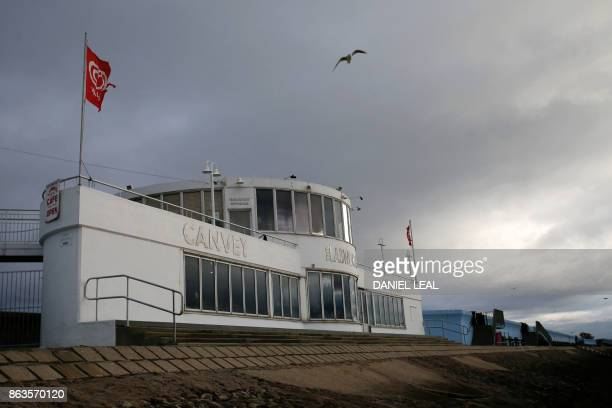 A seagull flies above the Labworth Cafe designed by the engineer Ove Arup and built in the 1930s to echo the bridge of the Queen Mary ocean liner at...
