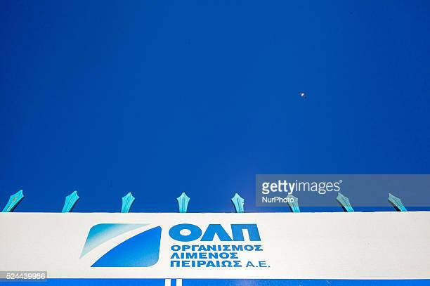 A seagull flies over a banner with the logo of Piraeus Port Authority in Piraeus on March 4 2015 China Ocean Shipping Company known as COSCO is the...