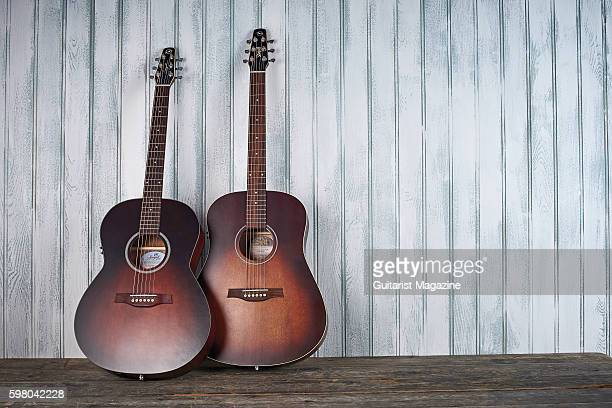 A Seagull S6 Original Burnt Umber Q1T and Seagull Entourage Folk Burnt Umber Q1T electroacoustic guitar taken on February 8 2016