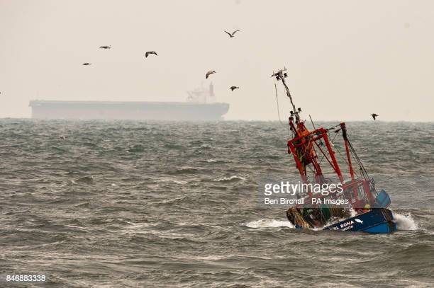 Seagulls circle fishing vessel the Girl Rona after it capsized at the entrance of Teignmouth harbour carrying about 2000 gallons of diesel and nearly...