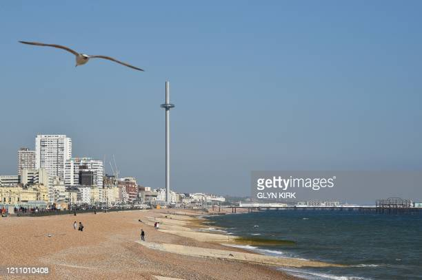 Seagulls fly above a neardeserted beach in Hove on the south coast of England on April 25 during the national lockdown due to the novel coronavirus...