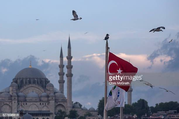 Seagulls fly over a Turkish flag on May 3, 2016 in Istanbul Turkey. The European Commission is expected to recommend granting Turks with visa free...