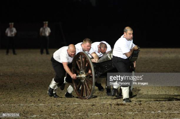 Seahawk from Cornwall compete in the field gun run during the Windsor Castle Royal Tattoo in Berkshire