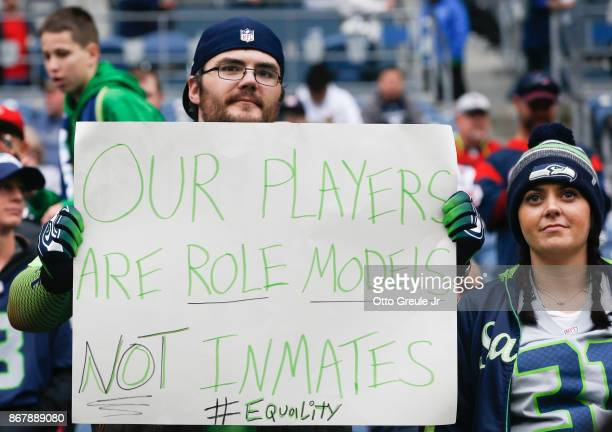 Seahawks fan holds a sign referencing a comment made by Houston Texans owner Bob McNair before the game between the Houston Texans and Seattle...