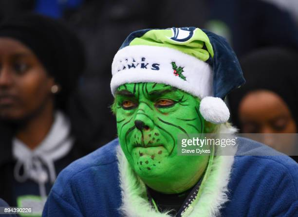 Seahawks fan in Grinch makeup watches the game during the third quarter against the Los Angeles Rams at CenturyLink Field on December 17 2017 in...