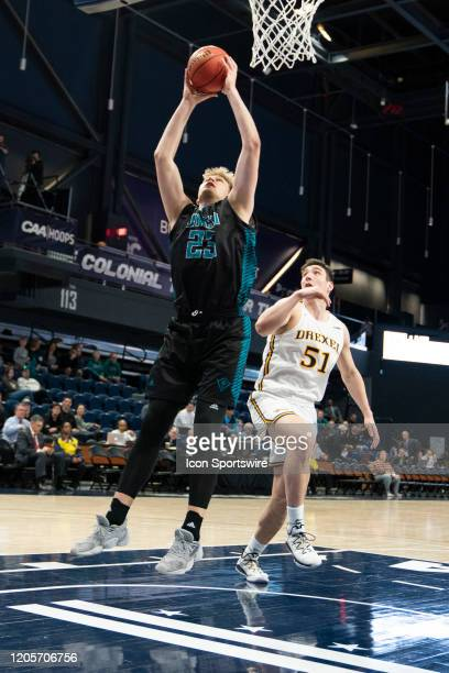 Seahawks Forward Marten Linssen shoots a layup during the first half of the Colonial Athletic Association Men's Basketball Championship Tournament...
