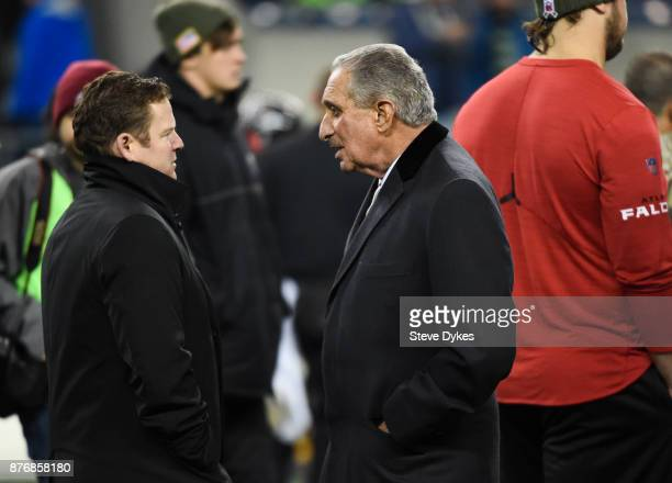 Seahawks general manager John Schneider talks with Atlanta Falcons owner Arthur Blank before the game at CenturyLink Field on November 20 2017 in...