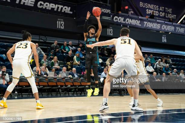 Seahawks Guard Ty Gadsden shoots a jump shot withDrexel Dragons Forward T.J. Bickerstaff and Drexel Dragons Forward James Butler defending during the...