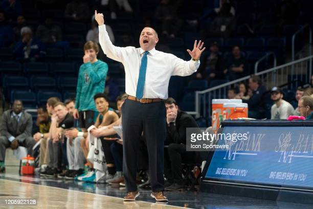Seahawks Head Coach Rob Burke yells to his players on the court during the first half of the Colonial Athletic Association Men's Basketball...