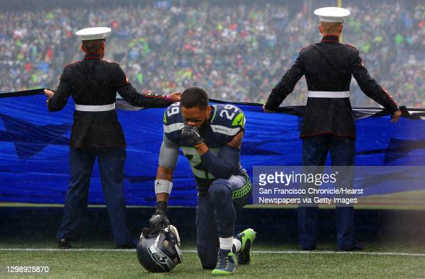 Seahawks safety Earl Thomas kneels to pray before the start of Seattle's game against Atlanta, Sunday Oct. 16 at CenturyLink Field.