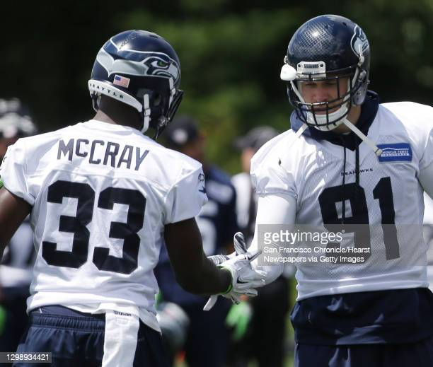 Seahawks strong safety Kelcie McCray greets defensive end Cassius Marsh during the team's minicamp at Virginia Mason Athletic Center in Renton, Wa.,...