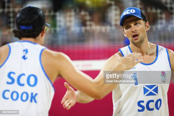 Seain Cook and Robin Miedzybrodzki of Scotland celebrate a point against Aboubakar Kamara and Patrick Lombi of of Sierra Leone during the Mens Beach...
