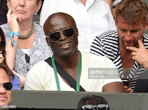 Seal attends the Sam Querry v Roger Federer match on day four of the Wimbledon Tennis Championships at Wimbledon on July 2 2015 in London England
