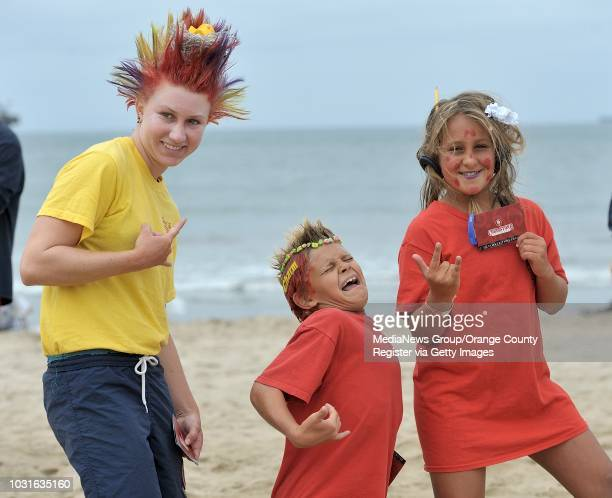 Seal Beach junior lifeguards Paige Cooper left Andrew Horvatin centerr and Kaya Desoto show off their crazy hair for a contest during the final day...