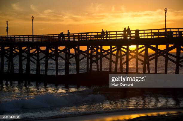 seal beach pier at sunset - seal beach stock pictures, royalty-free photos & images