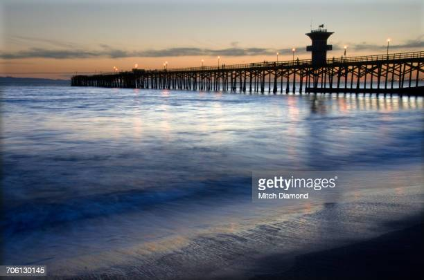 seal beach pier sunset - seal beach stock pictures, royalty-free photos & images