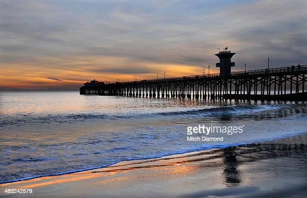seal beach sunset reflections - seal beach stock pictures, royalty-free photos & images