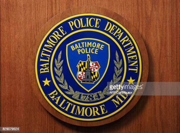 A seal of the Baltimore Police Department is seen at Police Headquarters in Baltimore on August 8 2017 Baltimore a city of 28 million is troubled by...