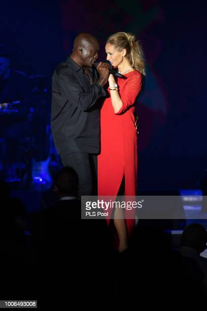 Seal performs on stage with Adriana Karembeu during the 70th Monaco Red Cross Ball Gala on July 27 2018 in MonteCarlo Monaco