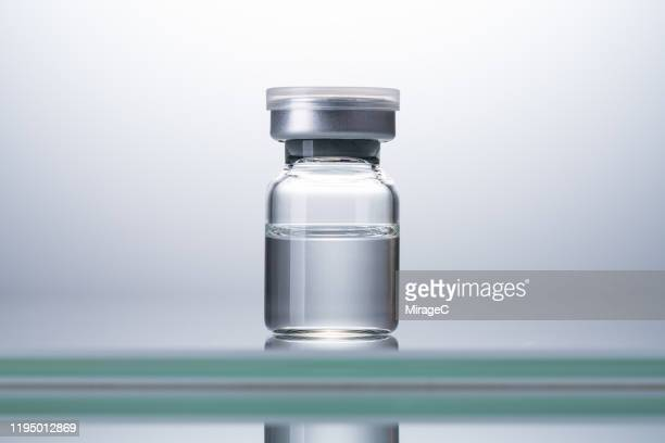 sealed airtight medical vial - バイアル ストックフォトと画像