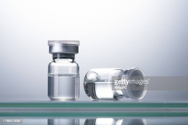 sealed airtight medical vials - dose stock pictures, royalty-free photos & images