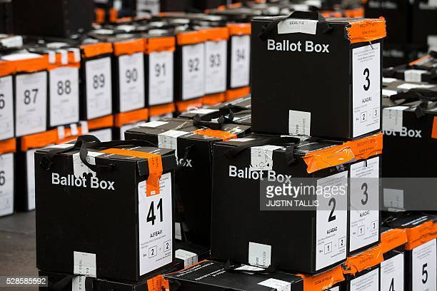 Sealed ballot boxes containing voting slips wait to be processed and the ballot papers counted at a count centre in north London on May 6 2016 Early...